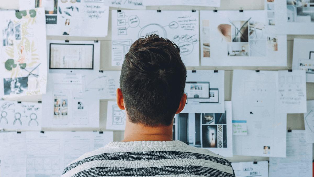 A man analyzing an idea board.